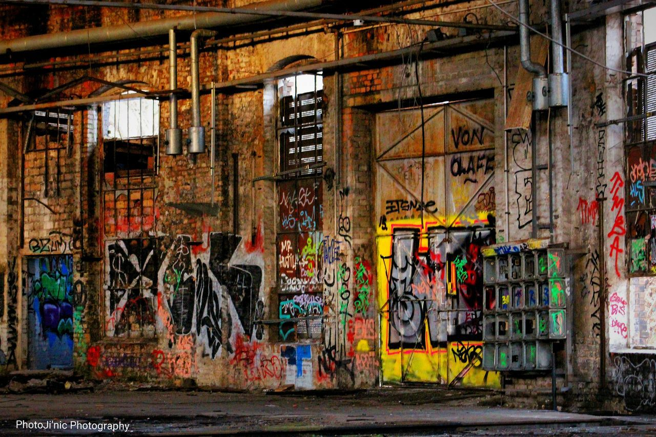 graffiti, street art, architecture, spray paint, built structure, multi colored, city, industry, no people, day, factory, ghetto, indoors, aerosol can