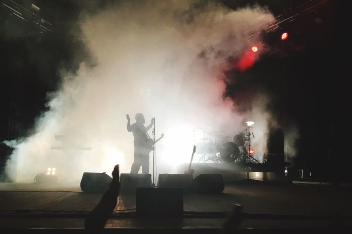 Music Arts Culture And Entertainment Real People Event Smoke - Physical Structure Performance Enjoyment Men Large Group Of People Stage - Performance Space Illuminated Music Festival Musical Instrument Indoors  Rock Music Night Musician Nightlife Crowd People