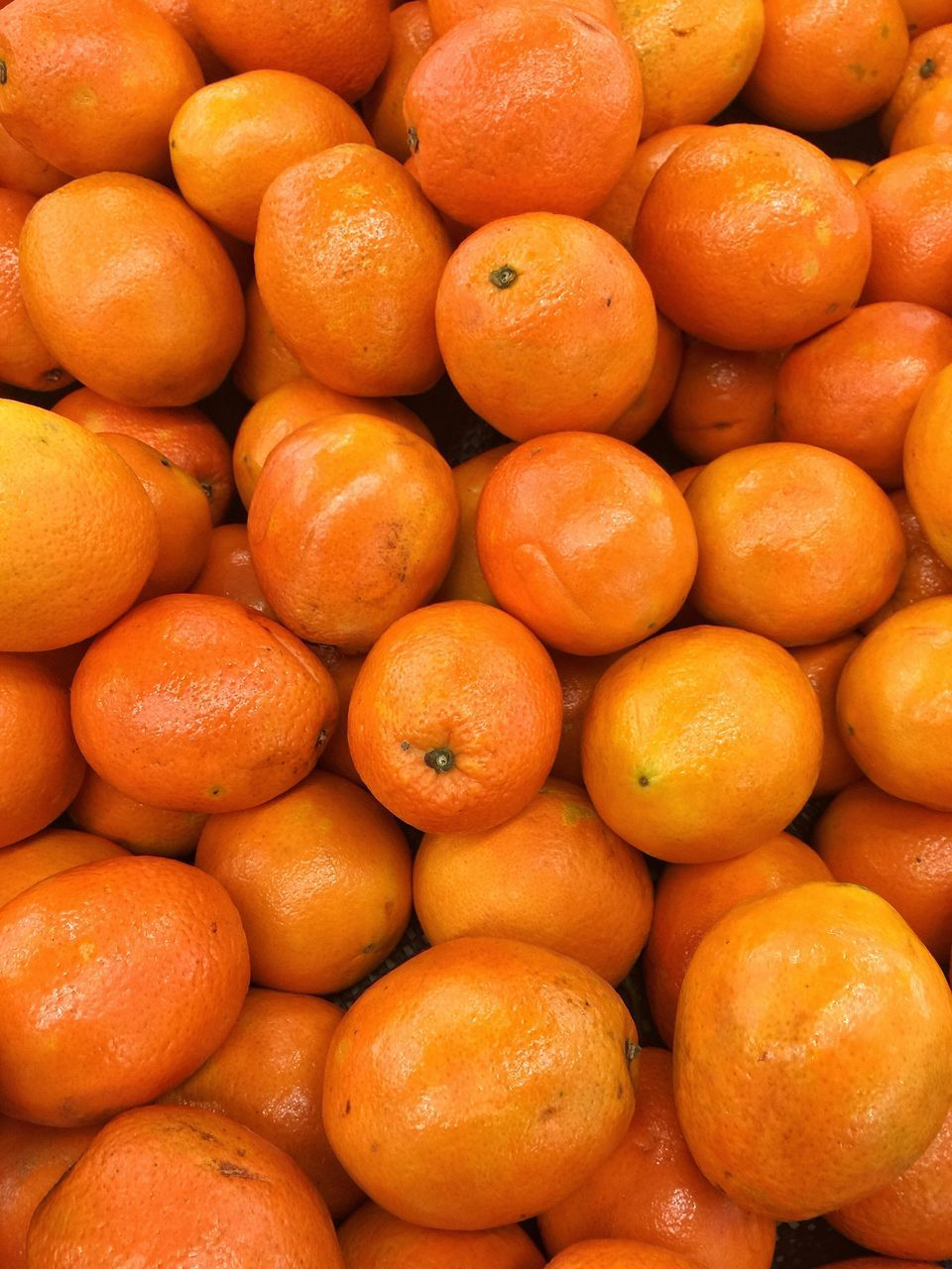 orange color, healthy eating, backgrounds, food and drink, fruit, freshness, food, abundance, market, full frame, large group of objects, for sale, citrus fruit, retail, no people, healthy lifestyle, close-up, farmer market, day, outdoors