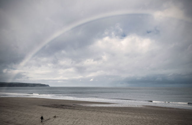 Rainbow over Whitby Beach. Atmosphere Beach Beauty In Nature Cloud - Sky Coastline Dog On Beach Horizon Over Water Outdoors Power In Nature Rainbow Sky Sand Sea Seascape Shore Sky Tranquil Scene Tranquility