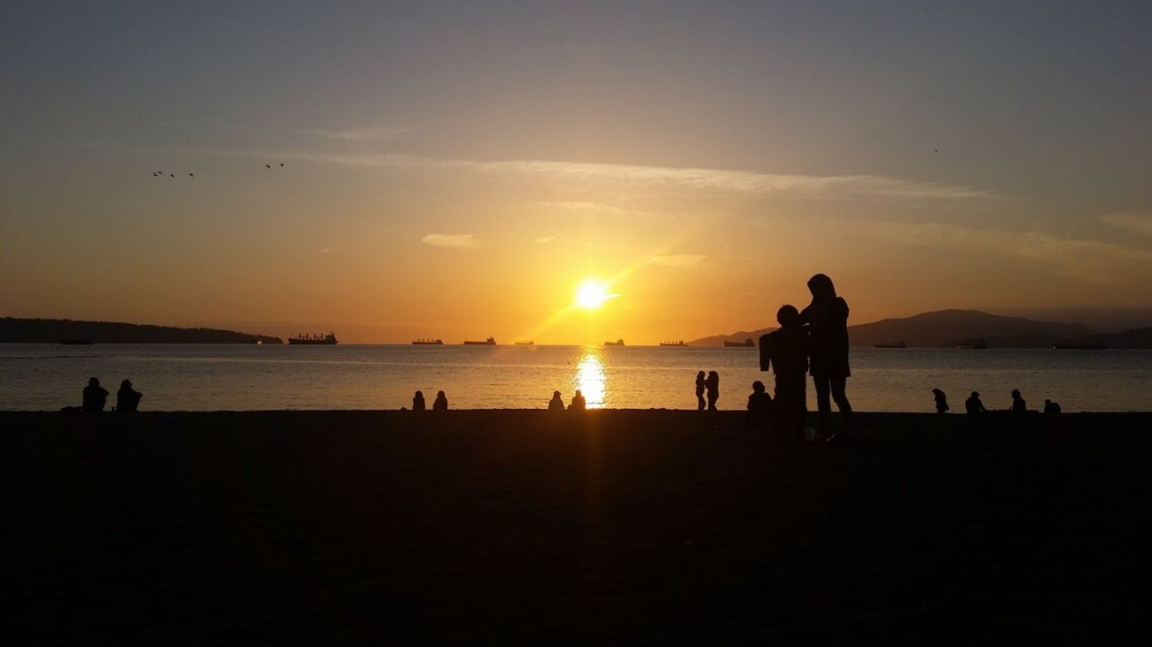 Sunset Beach, Vancouver, BC Sunset Sea Silhouette Water Real People Outdoors People IPhoneography Pairs EyeEmNewHere Unfiltered Vancouver British Columbia Canada Tranquil Scene