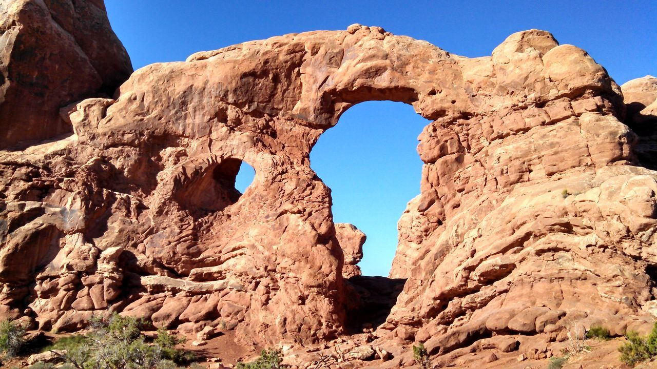 #arches #nationalpark #redrock #Utah Beauty In Nature Blue Clear Sky Cliff Eroded Geology Low Angle View Nature Old Ruin Physical Geography Rock Rock - Object Rock Formation Rough Sky Stone Sunlight Textured  Tranquil Scene Tranquility
