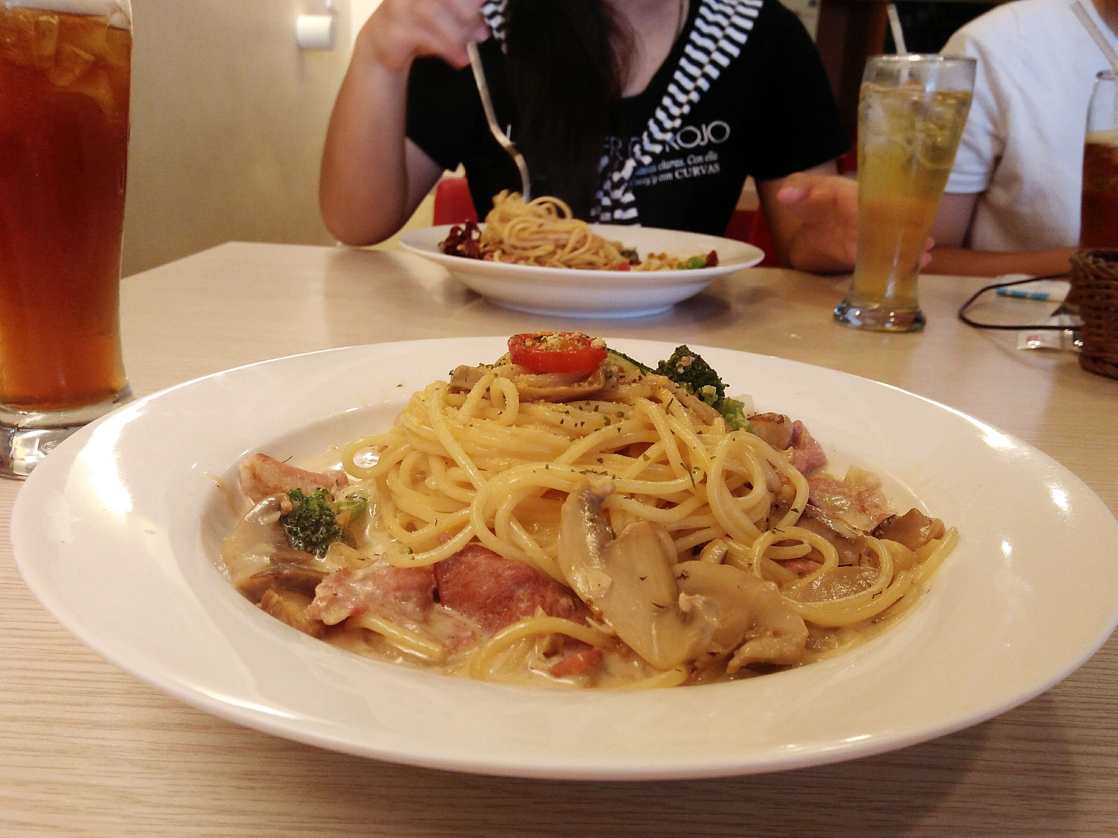 food and drink, plate, table, food, freshness, serving size, indoors, real people, fork, spaghetti, drinking glass, meal, drink, italian food, one person, healthy eating, ready-to-eat, close-up, human hand, day, people