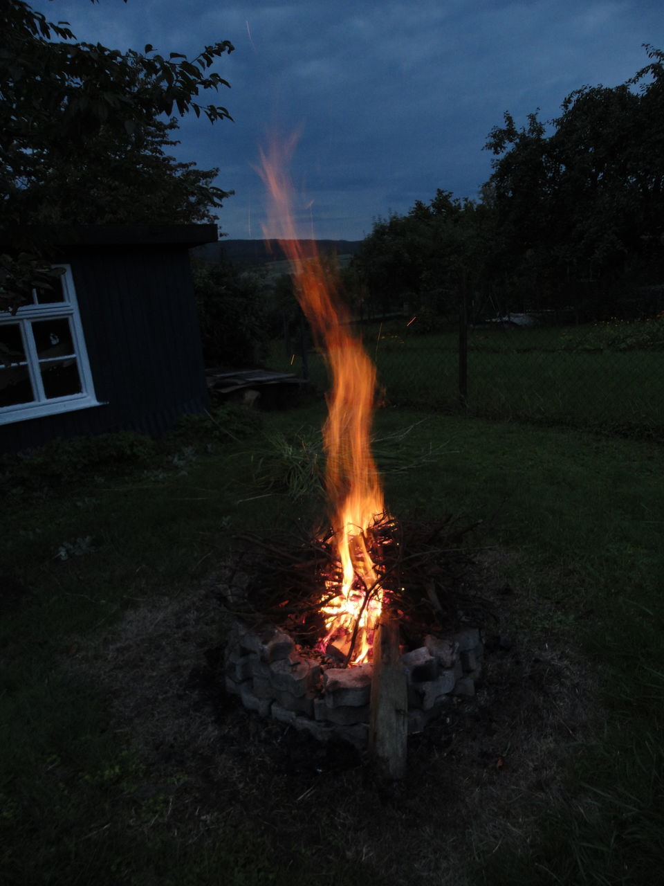 burning, flame, glowing, tree, no people, field, heat - temperature, smoke - physical structure, outdoors, bonfire, night, nature, sky, grass