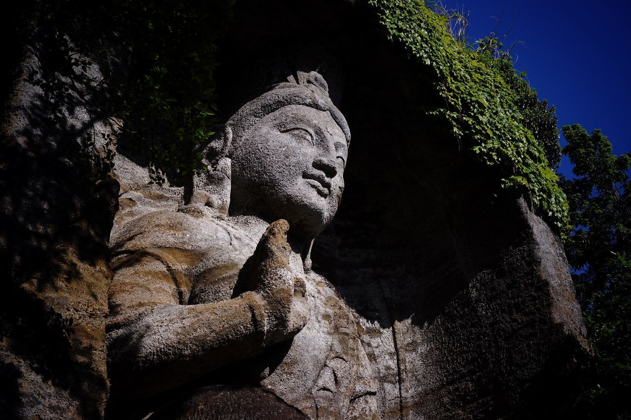 Stone Buddhist Image Stone Statue Stone Material Low Angle View Blue Sky