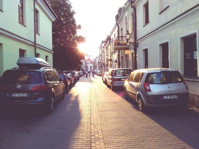 Car Building Exterior Architecture City Street Sunbeam Sun Sky Outdoors Lens Flare Sunrise Polishpriest Pokojartura Arturhippe No People Zamość