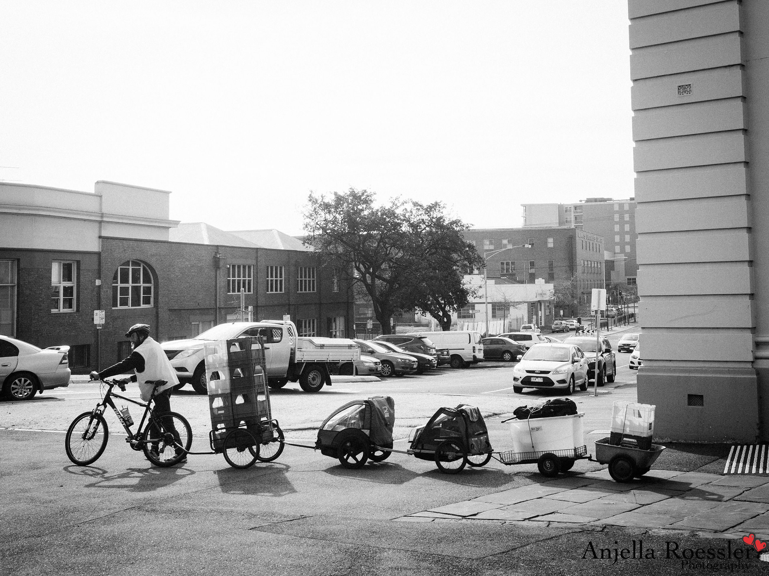 transportation, land vehicle, mode of transport, bicycle, building exterior, architecture, built structure, parked, stationary, parking, street, car, city, riding, men, motorcycle, city life, road, travel
