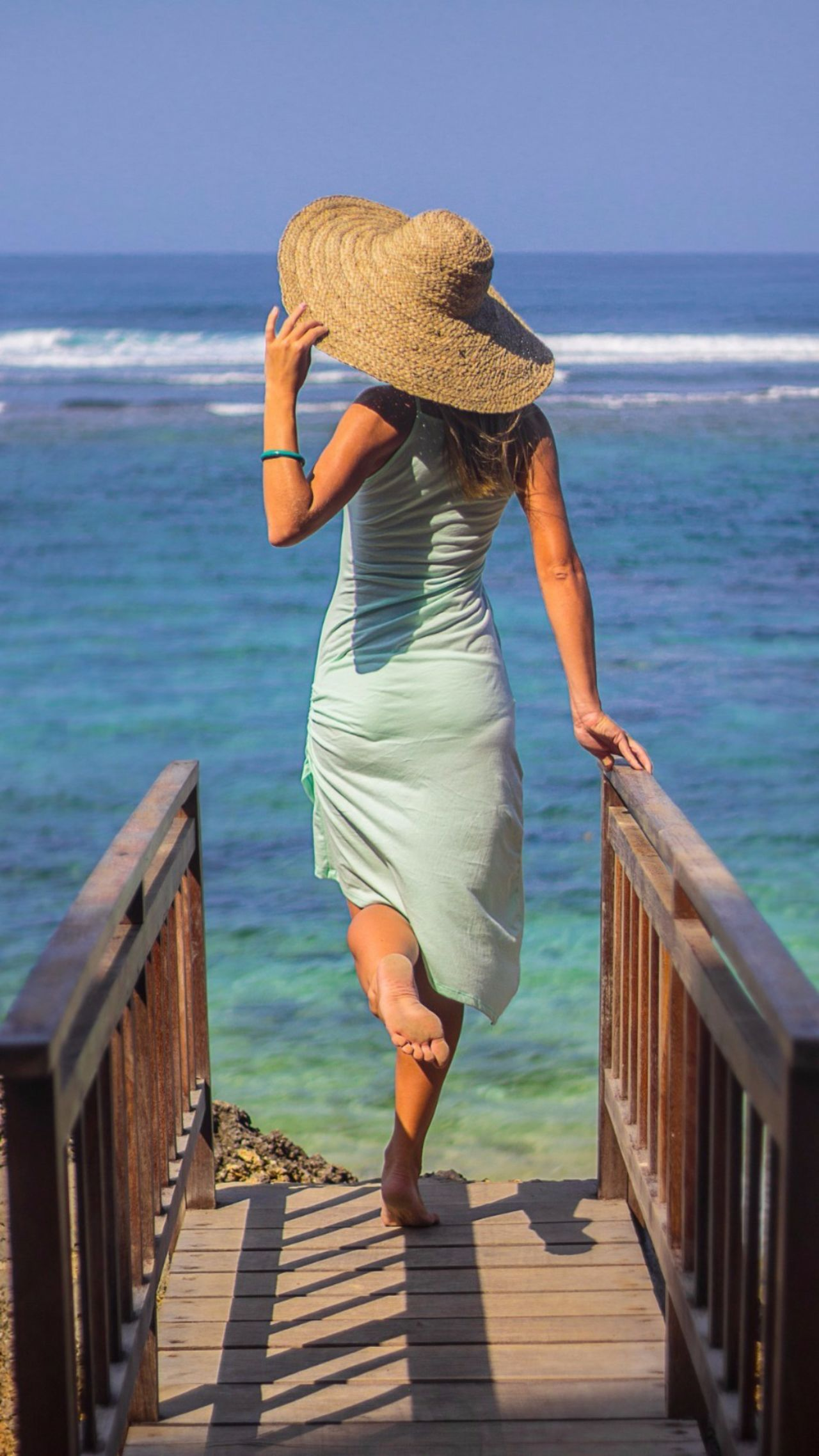 MeMyself&I Life Is A Beach Sea And Sky Sea View Blue Wave Blue Water Blue Sea Sky And Clouds Beachphotography Beach Bridge Hat Girl Life Is Beautiful Amazingindonesia Bali, Indonesia Seaandsun Woman Women Of EyeEm People Photography Midday Sunlight Ocean View Seascape