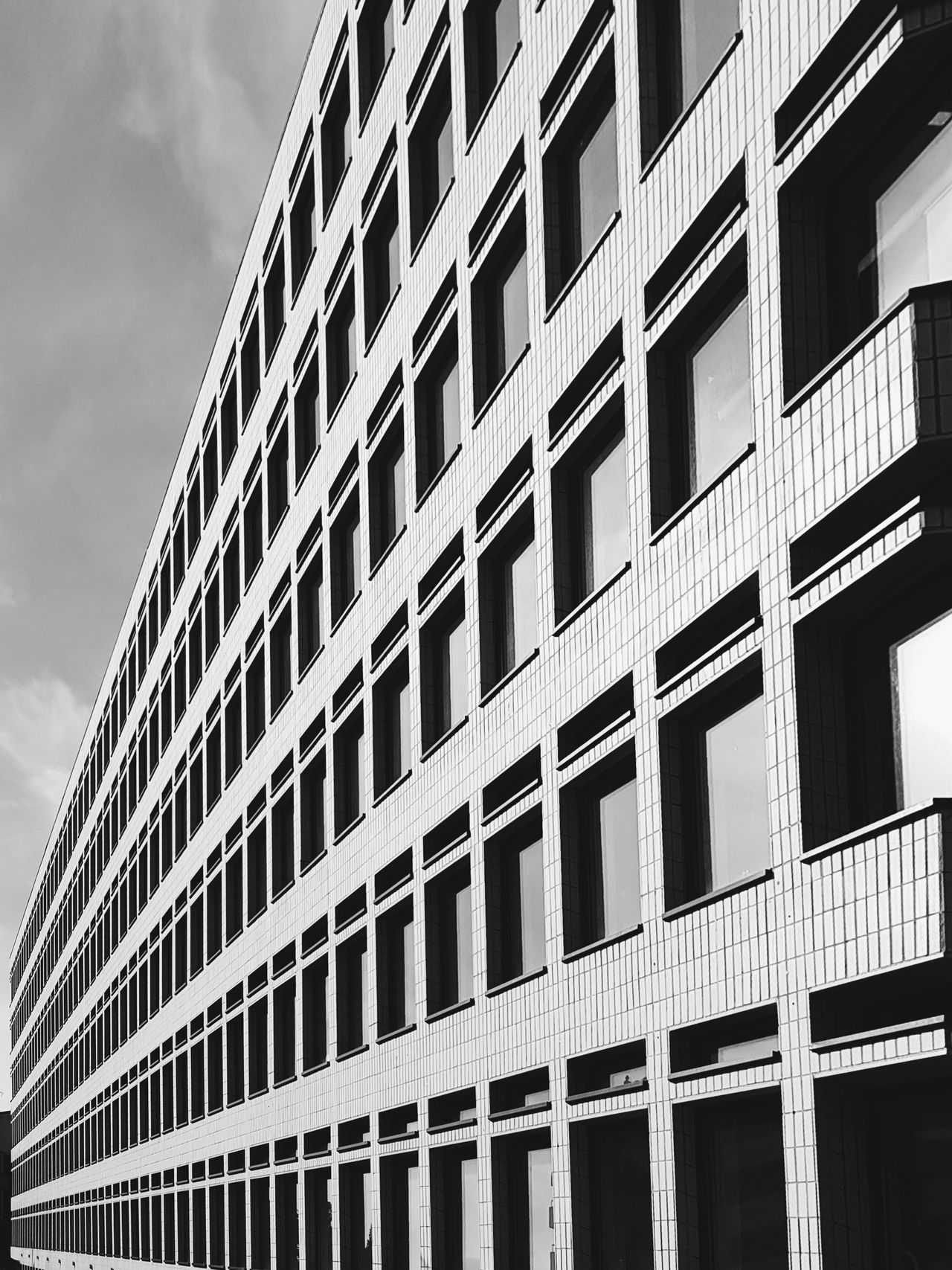 Just another boring office building. Shoreditch, London Architecture Window Building Exterior Built Structure Façade Modern City No People Outdoors Skyscraper Day Sky Monochrome Photography Architecture Business Finance And Industry City Cityscape Illuminated City Street Low Angle View Modern City Life Street Photography London