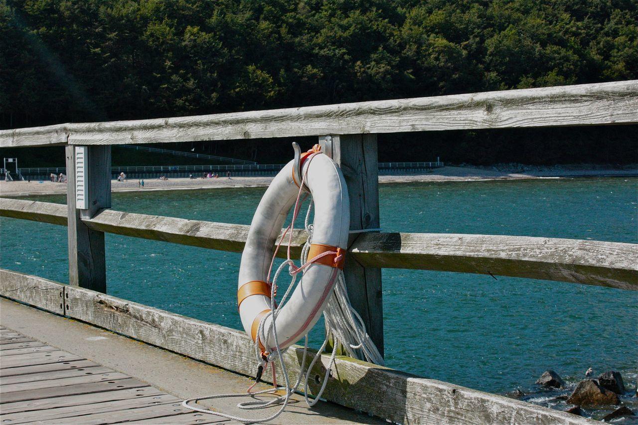 Boat Deck Day Dockside Life Belt Lifebelt Nature Nautical Vessel Ocean Life Ostsee Outdoors Railing Real People Rettungsring River Rügen Rügen Lovers Seascape Seaside Seebrücke Still Life Water