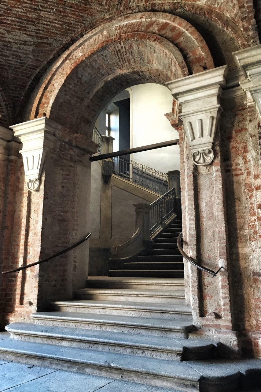 steps, architecture, staircase, steps and staircases, built structure, arch, railing, history, architectural column, low angle view, no people, day, indoors