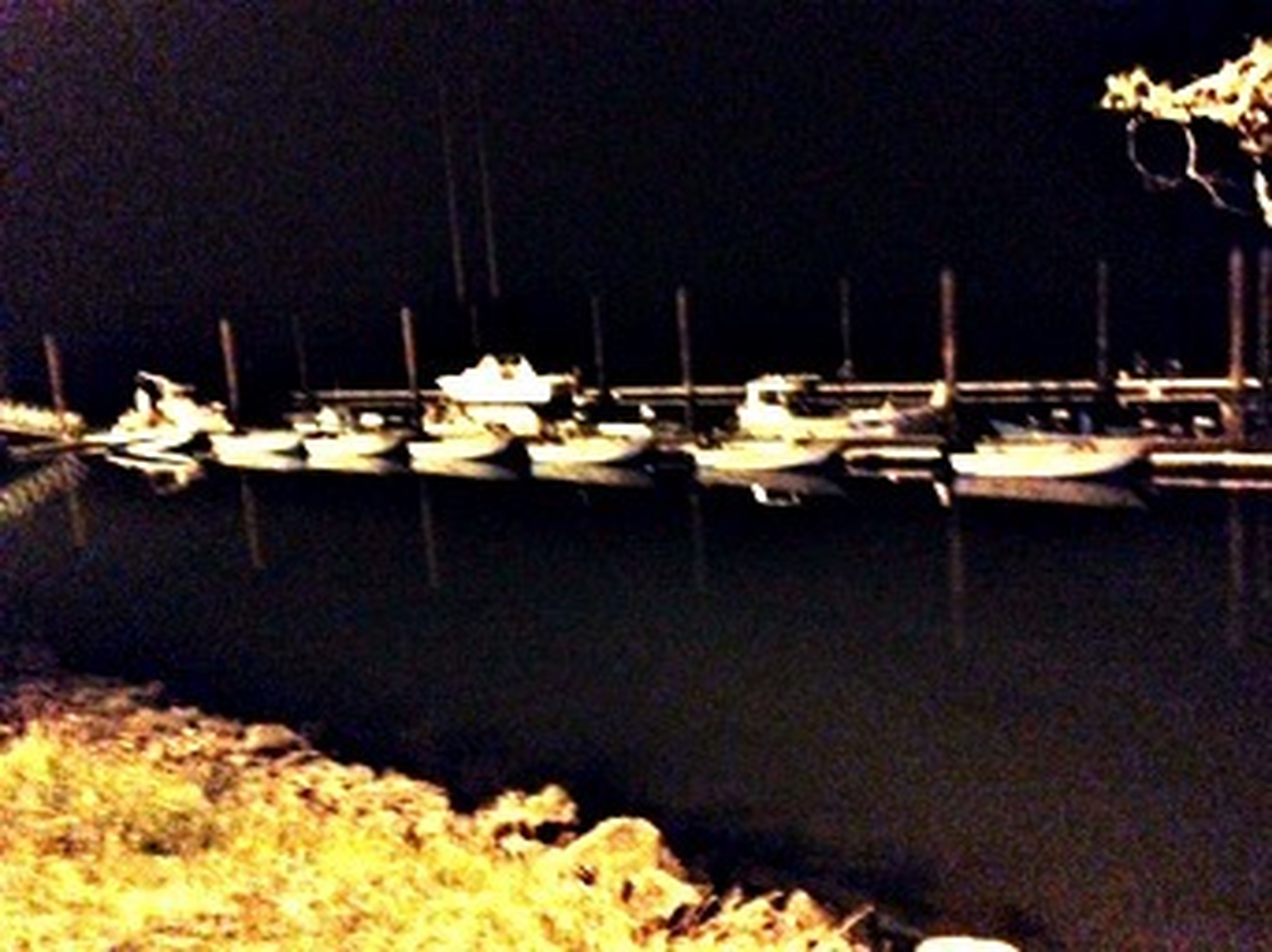 nautical vessel, moored, boat, transportation, night, mode of transport, water, illuminated, reflection, harbor, copy space, mast, waterfront, no people, in a row, sea, outdoors, group of objects, sailboat, nature