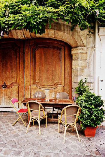 Empty Table Front Or Back Yard Outdoors Parisian Cafe Plant Roof Potted Plant Steet Cafe Table Building Exterior