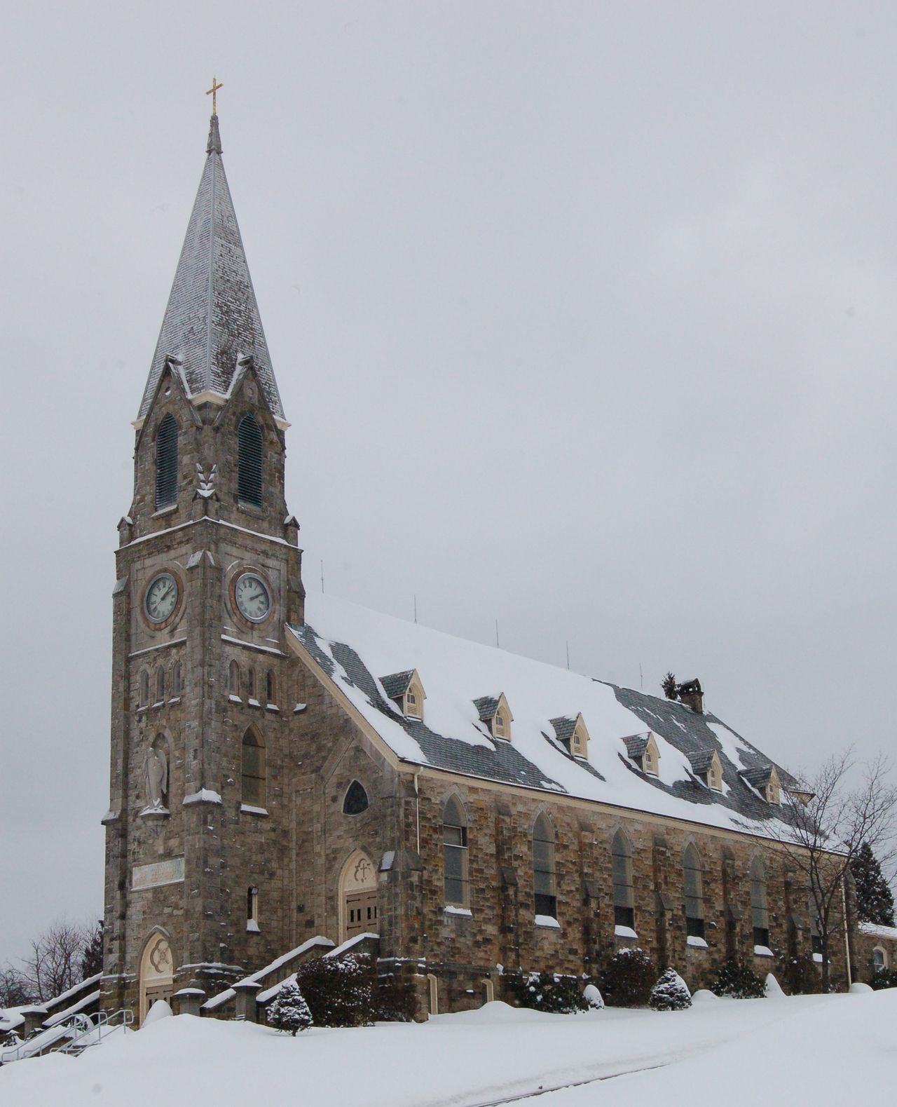 Church in Fryburg, Pennsylvania. Architecture Building Exterior Built Structure Church Cold Temperature Day Fryburg, Pennsylvania Low Angle View No People Outdoors Overast Sk Place Of Worship Religion Sky Snow Snowdrift Spirituality Tranquility Travel Destinations Tree Weather Winter
