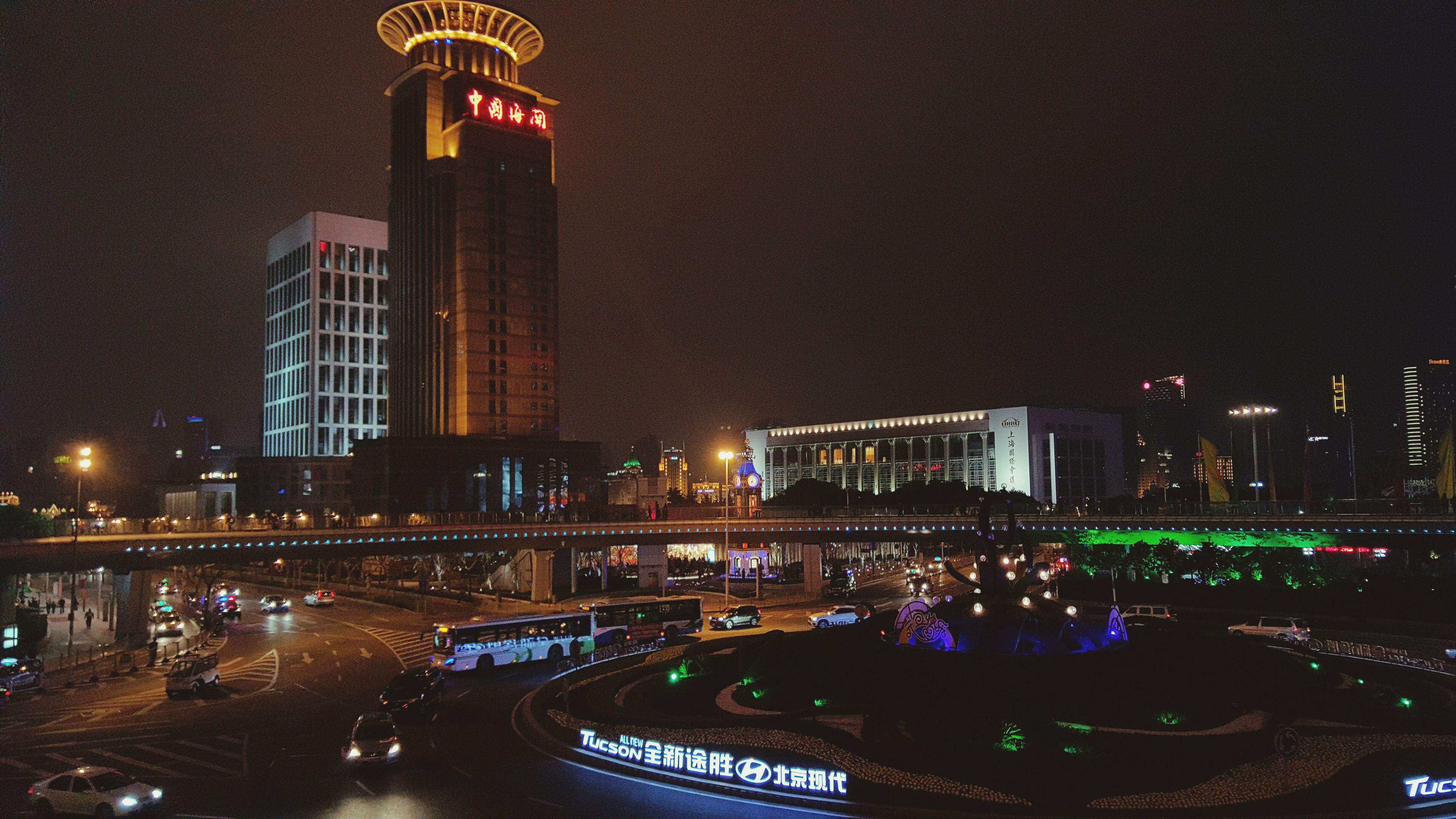 illuminated, architecture, night, built structure, building exterior, city, skyscraper, tall - high, modern, tower, capital cities, cityscape, office building, travel destinations, famous place, city life, clear sky, international landmark, urban skyline, travel