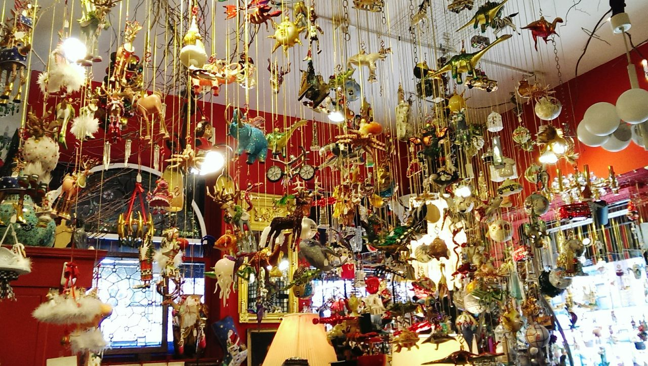 hanging, retail, no people, arts culture and entertainment, choice, indoors, large group of objects, illuminated, day, carousel