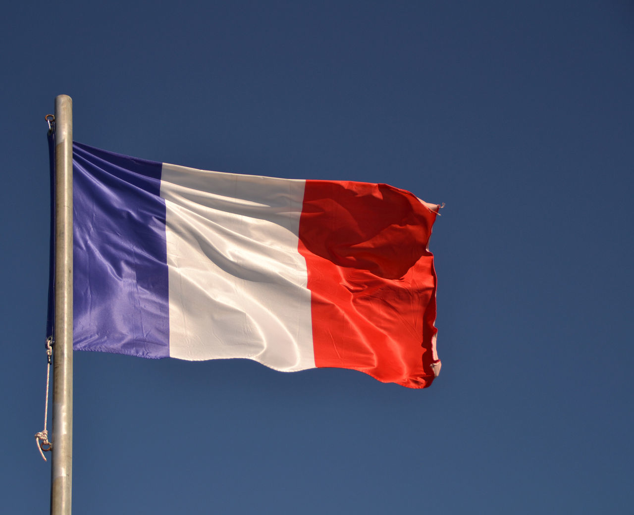 View of France flag waving Blue Clear Sky Colors Continent Countries Country Europe European  Flag France French International Nation National Outdoors Patriotism Red Red Sign Sky Symbol Travel Wave Waving White Color