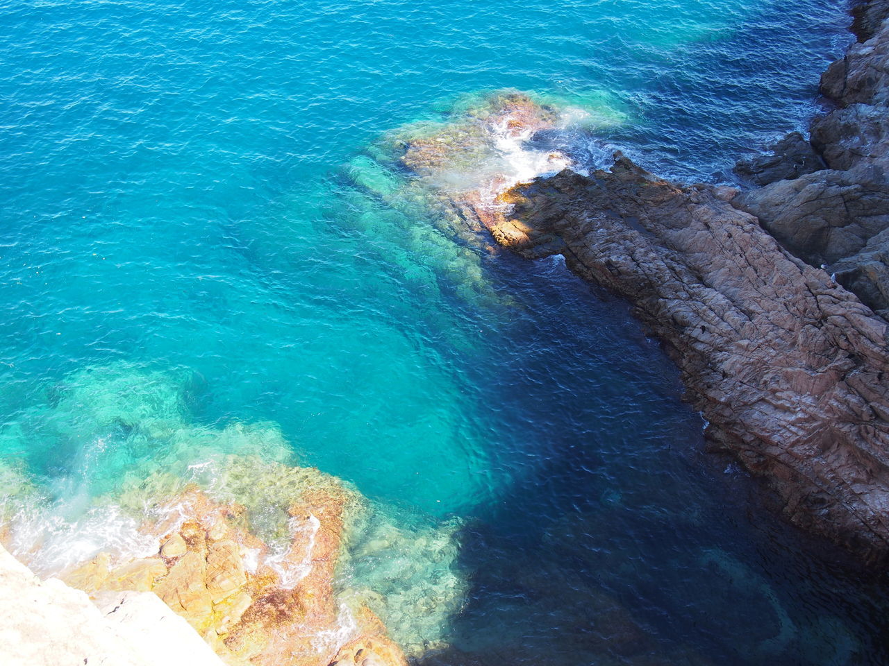 High Angle View Of Rocky Shore And Sea