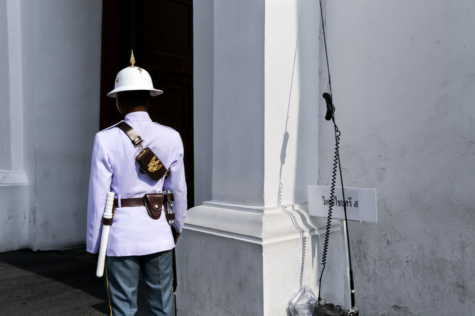 Outside the Grand Palace, Bangkok, Thailand Adults Only Bangkok Contrast Grand Palace Grand Palace Bangkok Thailand Guard Guardian Guarding Hardhat  Headwear One Man Only Outdoors Rear View Royalguard Royalty Shadows Siam South East Asia Street Photography Streetphoto Streetphotography Thailand Uniform UNPOSED Watchman