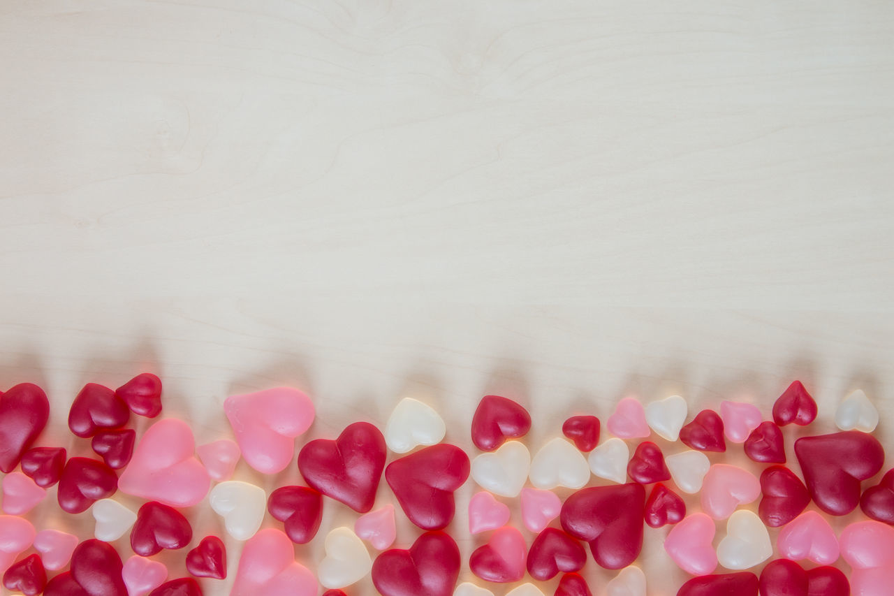 Directly Above Shot Of Heart Shape Decorations On Table