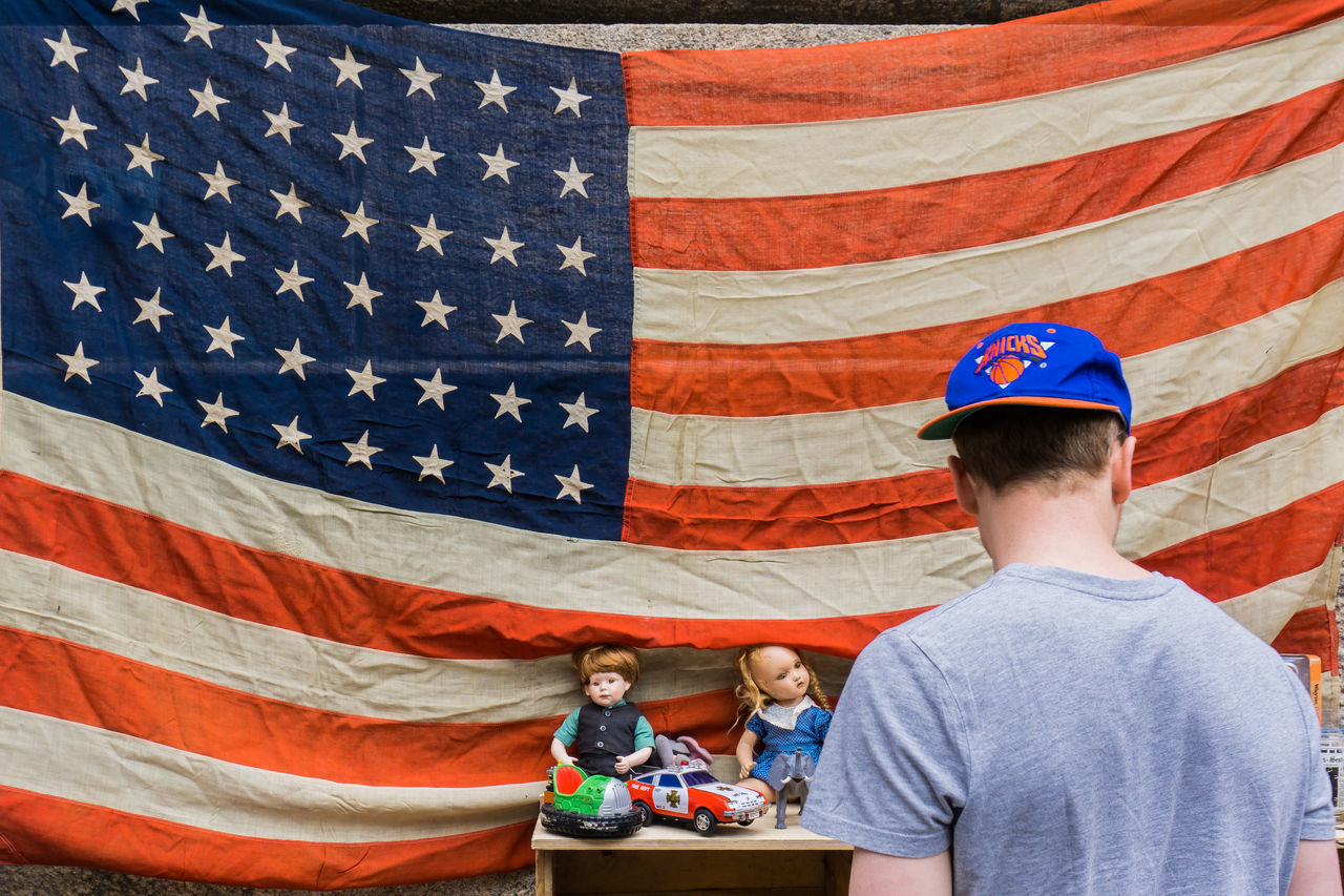 Be proud of it! American Flag DUMBO, Brooklyn From Behind Knicks Proud Baseball Cap Baseball Hat Dolls Flag Background Fleamarket Man Looking Red White And Blue Single Person Standing Man Star And Stripes White Man