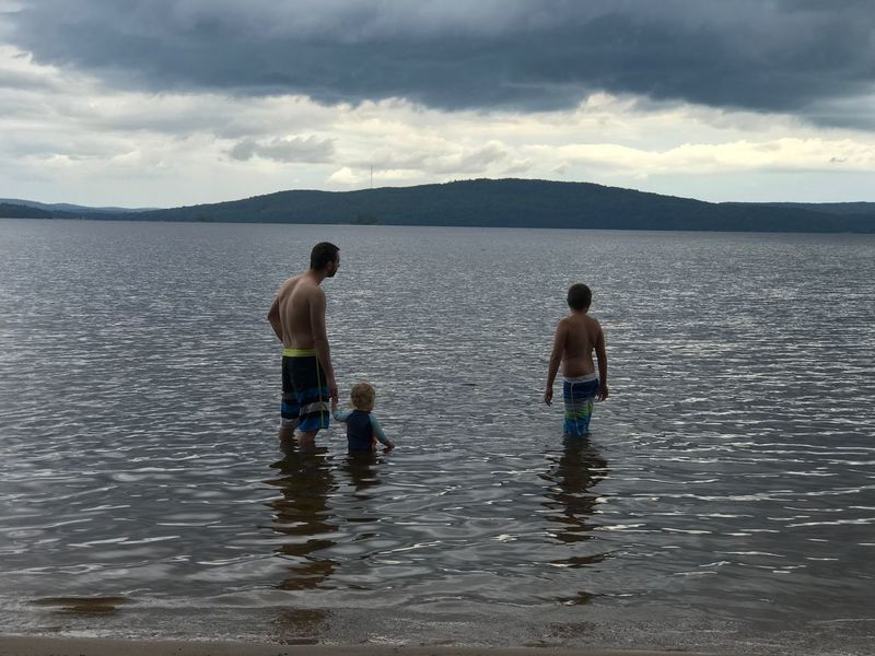 No storm is going to cut short some fun time in the lake. Lost In The Landscape Water Lake Daytime IPhoneography Outdoors Beauty In Nature Stormy Weather Grey Sky Having Fun In The Water The Boys Of Summer Family❤ My boys at the Beach