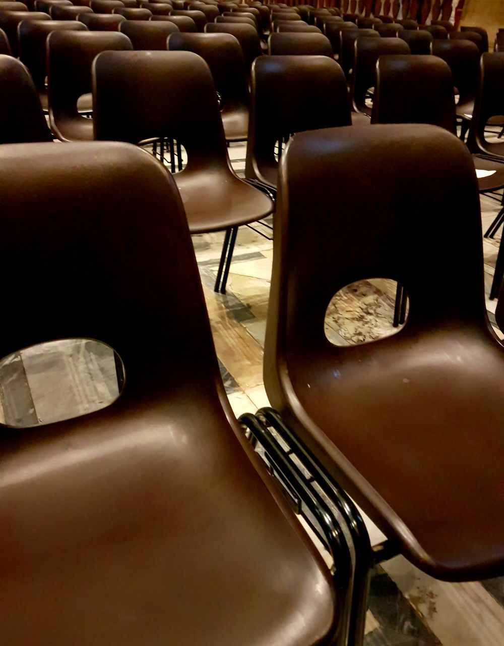 in a row, chair, empty, seat, arts culture and entertainment, no people, absence, indoors, auditorium, close-up, day