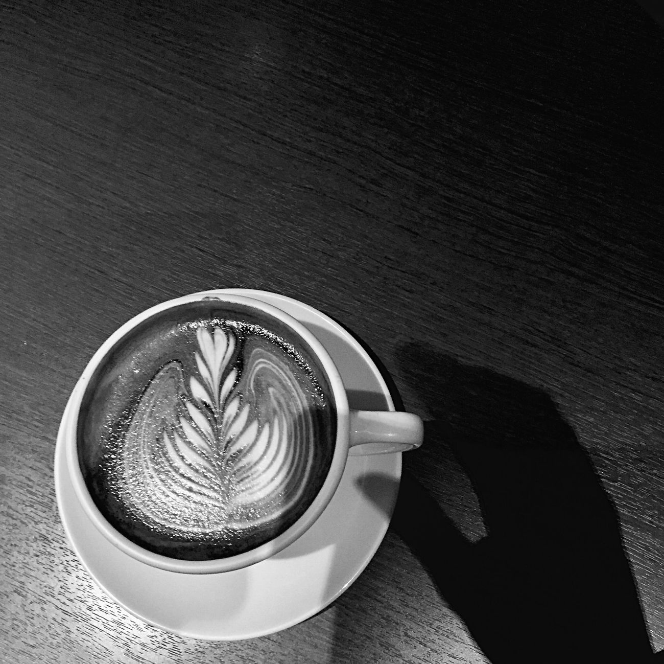Coffee - Drink Coffee Cup Drink Refreshment High Angle View Table Coffee Coffee Time Addiction Love Latte Latteart Flower No People Shadow My Hand  Blackandwhite Black & White IPhoneography after this morning work.