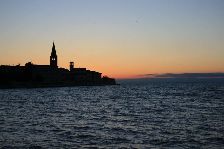 Porec, Croatia silhouette Waterfront Architecture Built Structure Water Sunset Building Exterior Sea Scenics Rippled Silhouette Copy Space Clear Sky Tranquil Scene River Tranquility Idyllic Orange Color Nature Blue Beauty In Nature Porec Croatia