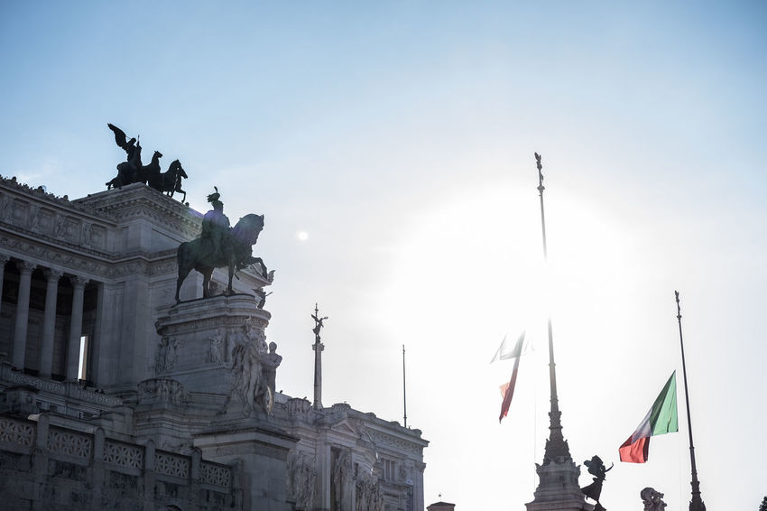 Italia Vittoriano Architecture Art And Craft Bandiere Building Exterior Built Structure City Controluce Day Flag History Human Representation Low Angle View No People Outdoors Patriotism Sculpture Sky Statue Travel Destinations