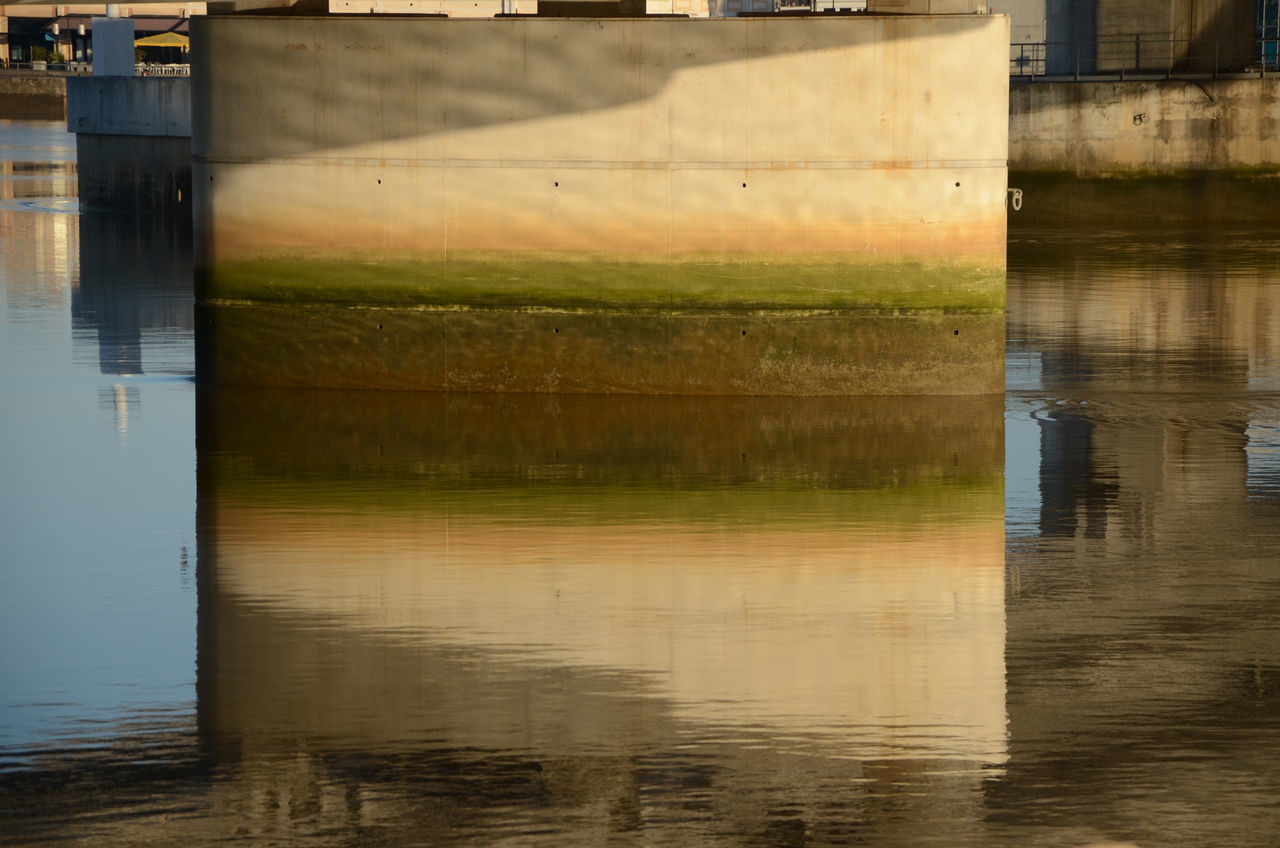 reflection, water, waterfront, architecture, no people, built structure, outdoors, river, day, building exterior, nature, sky