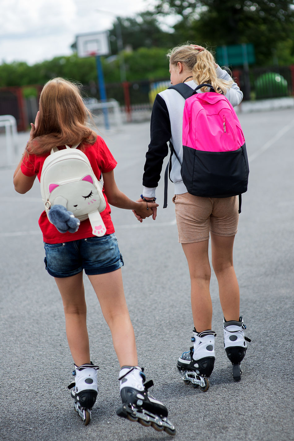 Students Backpack Bonding Casual Clothing Childhood Day Elementary Age Focus On Foreground Friendgirl Friendship Full Length Girls Leisure Activity Lifestyles Outdoors Pink Color Real People Rear View Rollerskates Schoolgirls Togetherness Two People Women Young Adult Young Women