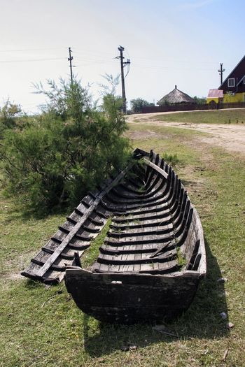 DanubeDelta Sulina Boat Damaged Damaged And Wrecked Danube România Grass No People Rusty Wrecked Wrecked Boat.