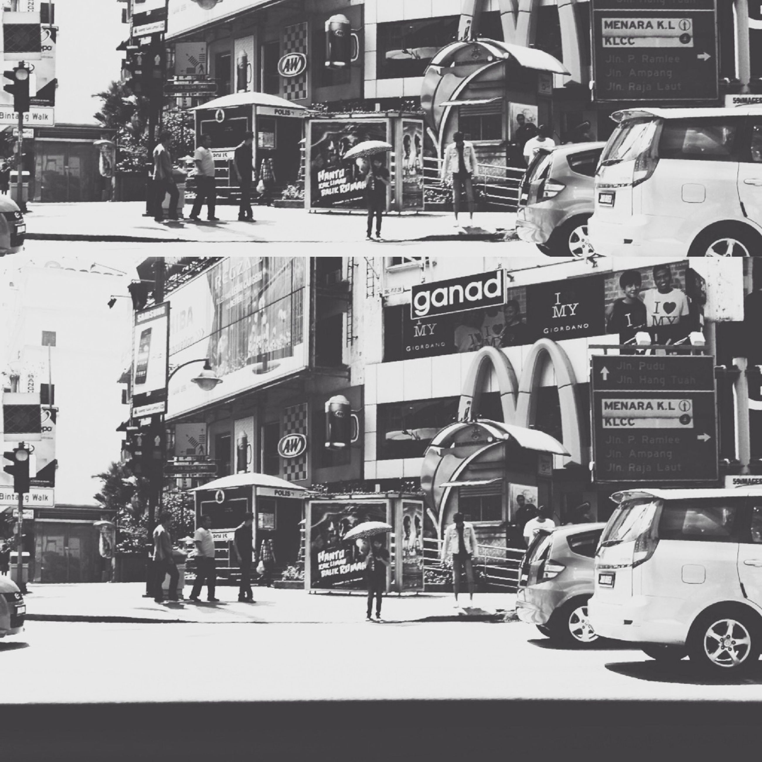 transportation, building exterior, street, architecture, built structure, city, land vehicle, mode of transport, lifestyles, men, city life, car, text, communication, full length, road, leisure activity, walking