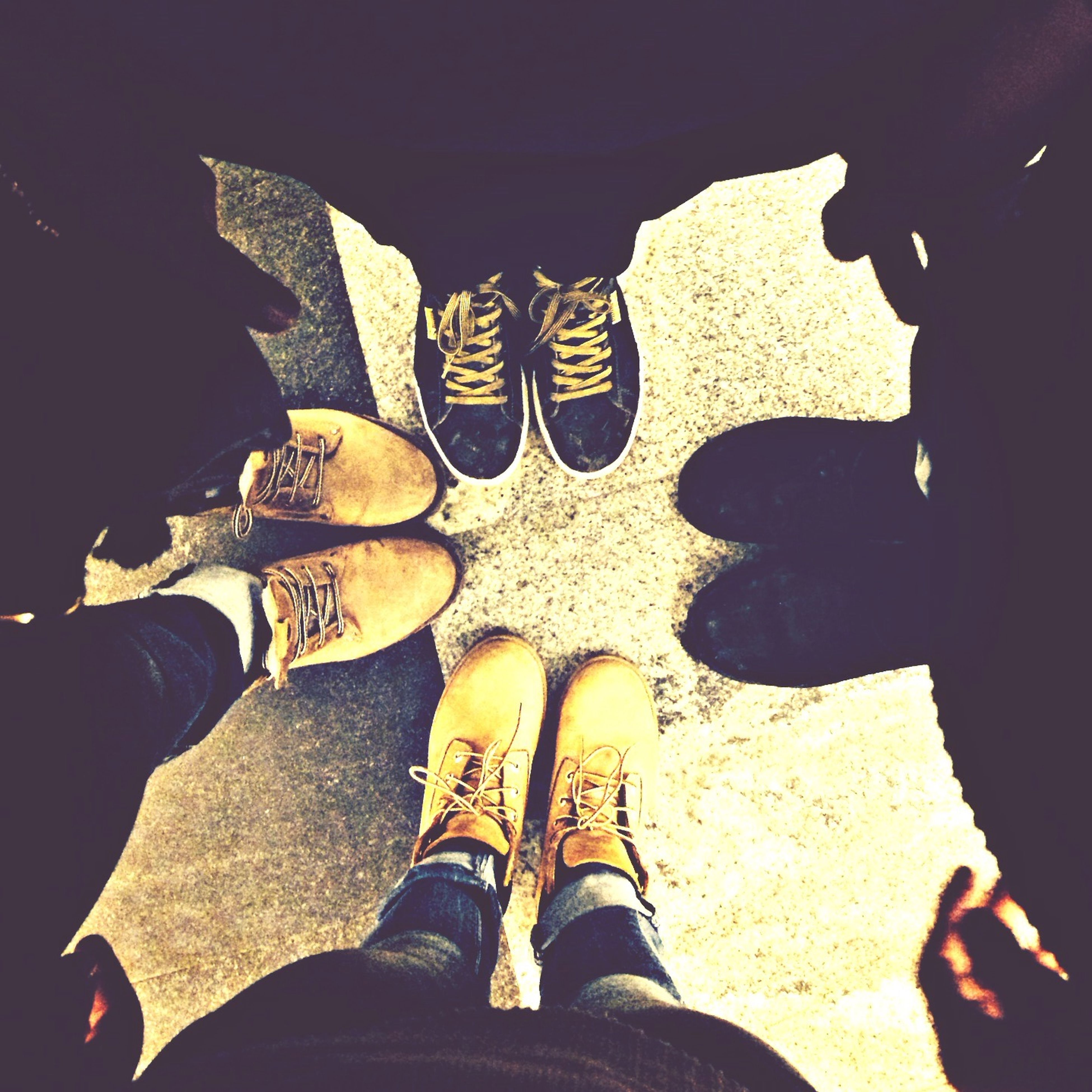 low section, person, shoe, standing, lifestyles, togetherness, men, personal perspective, leisure activity, bonding, human foot, friendship, footwear, jeans, high angle view, casual clothing