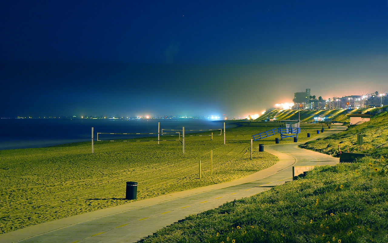 Footpath By Sea Against Sky At Night