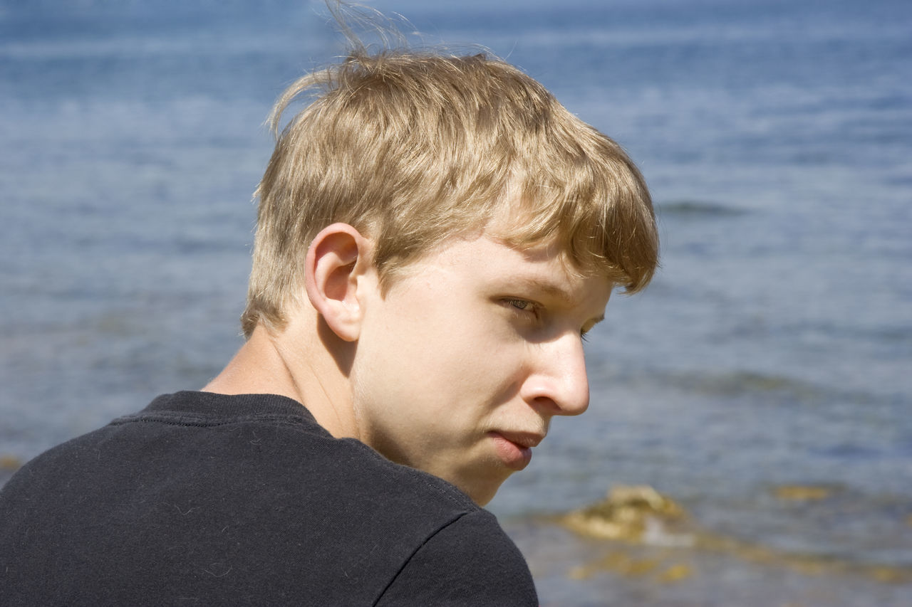 teen portrait - in front of the ocean Adolescence  Blond Hair Boy Caucasian Cheerful Close-up Confidence  Cool Happy Head And Shoulders Headshot Kid Mediterranean Sea One Boy Only One Teenage Boy Only Portrait Profile Real People Sea Smiling Smirk Teen Teenage Boy Teenager Water