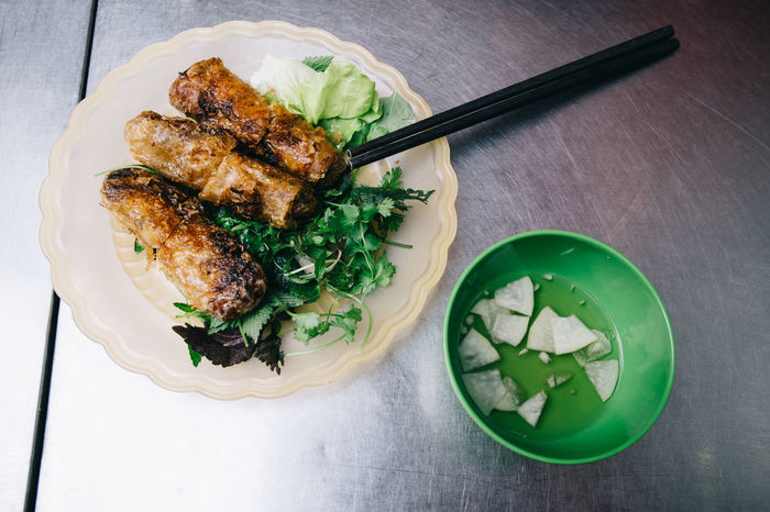 Spring Rolls in Hanoi, Vietnam Appetizer Chopsticks Delicious Dinner Eating Food Food And Drink Freshness Fried Greens Hanoi Healthy Eating Hot Indoors  Lunch No People Plate Plates Ready-to-eat Spring Rolls Travel Vacation Vietnam Vietnamese Yummy