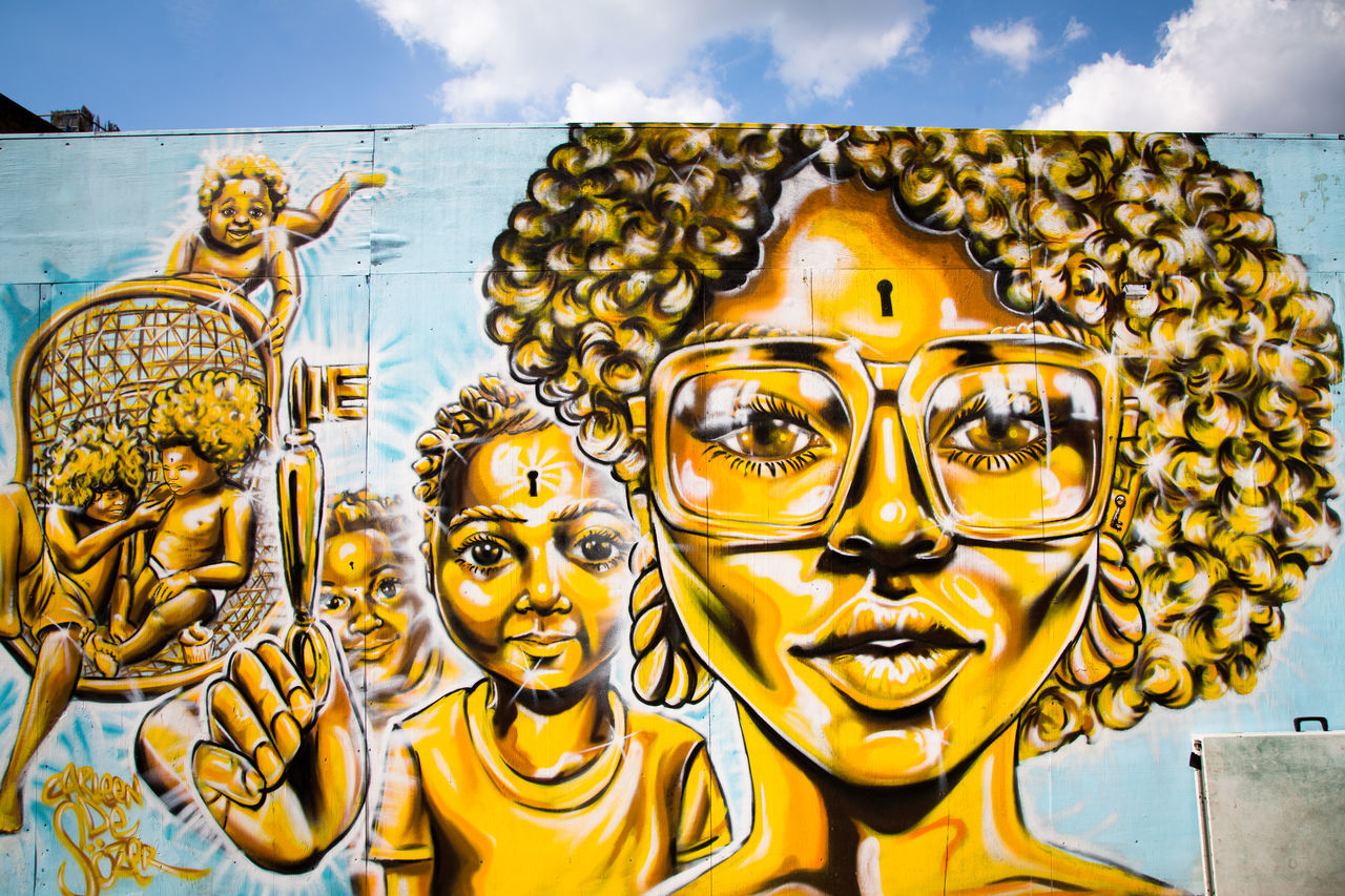 Architecture Art And Craft Artist Cloud - Sky Day Gold Gold Colored Human Representation No People Outdoors Sky Spirituality Street Art Street Photography Streetart Wall Art Yellow