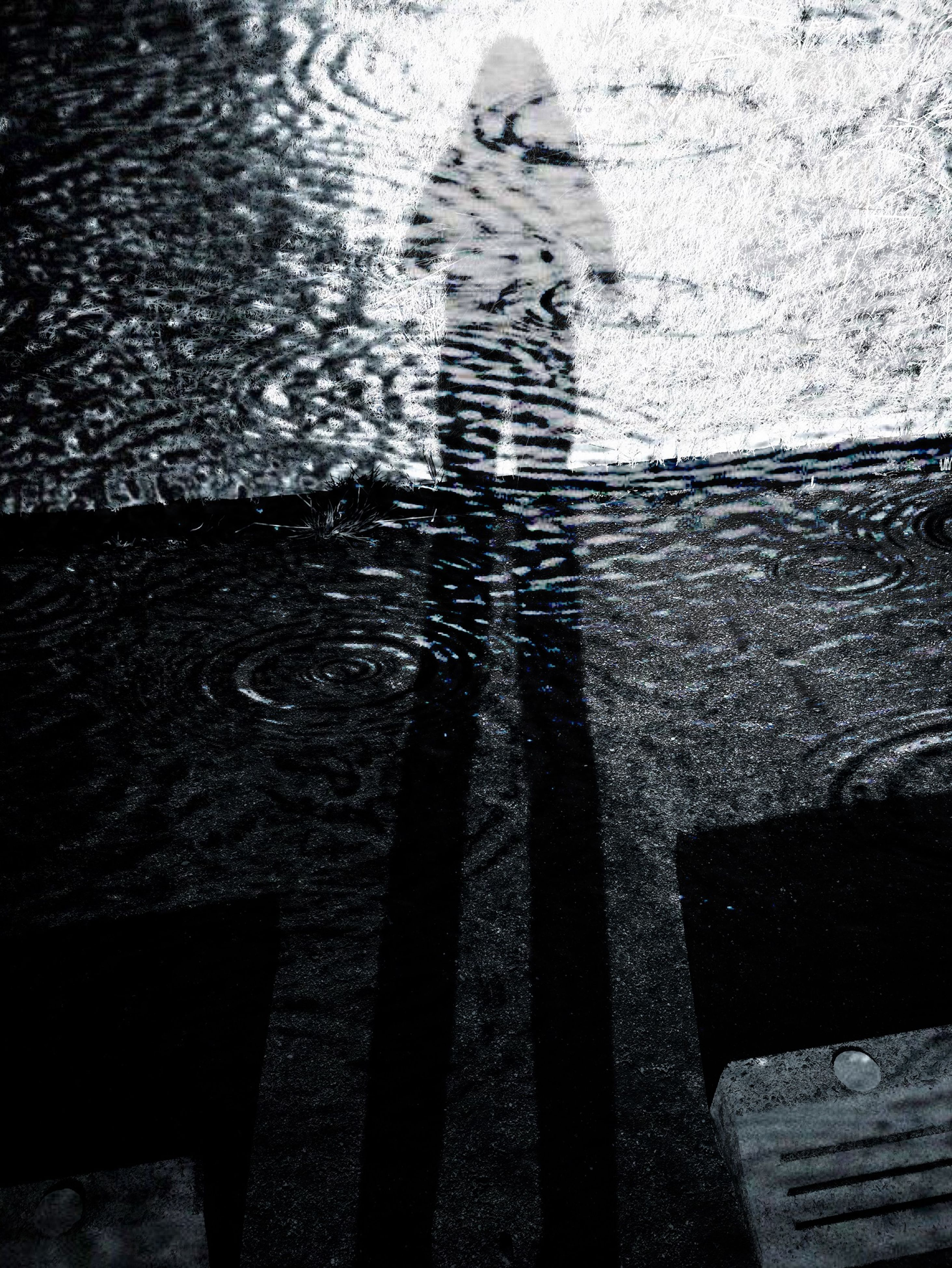 shadow, high angle view, sunlight, water, street, silhouette, focus on shadow, puddle, outdoors, built structure, day, wet, textured, building exterior, reflection, architecture, cobblestone, unrecognizable person, sidewalk