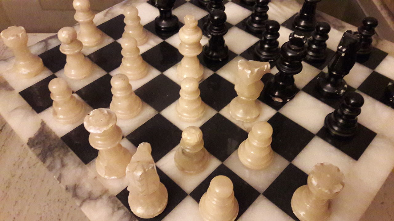 chess, chess piece, indoors, still life, chess board, strategy, leisure games, close-up, large group of objects, no people, high angle view, pawn - chess piece, knight - chess piece, arrangement, black color, king - chess piece, queen - chess piece