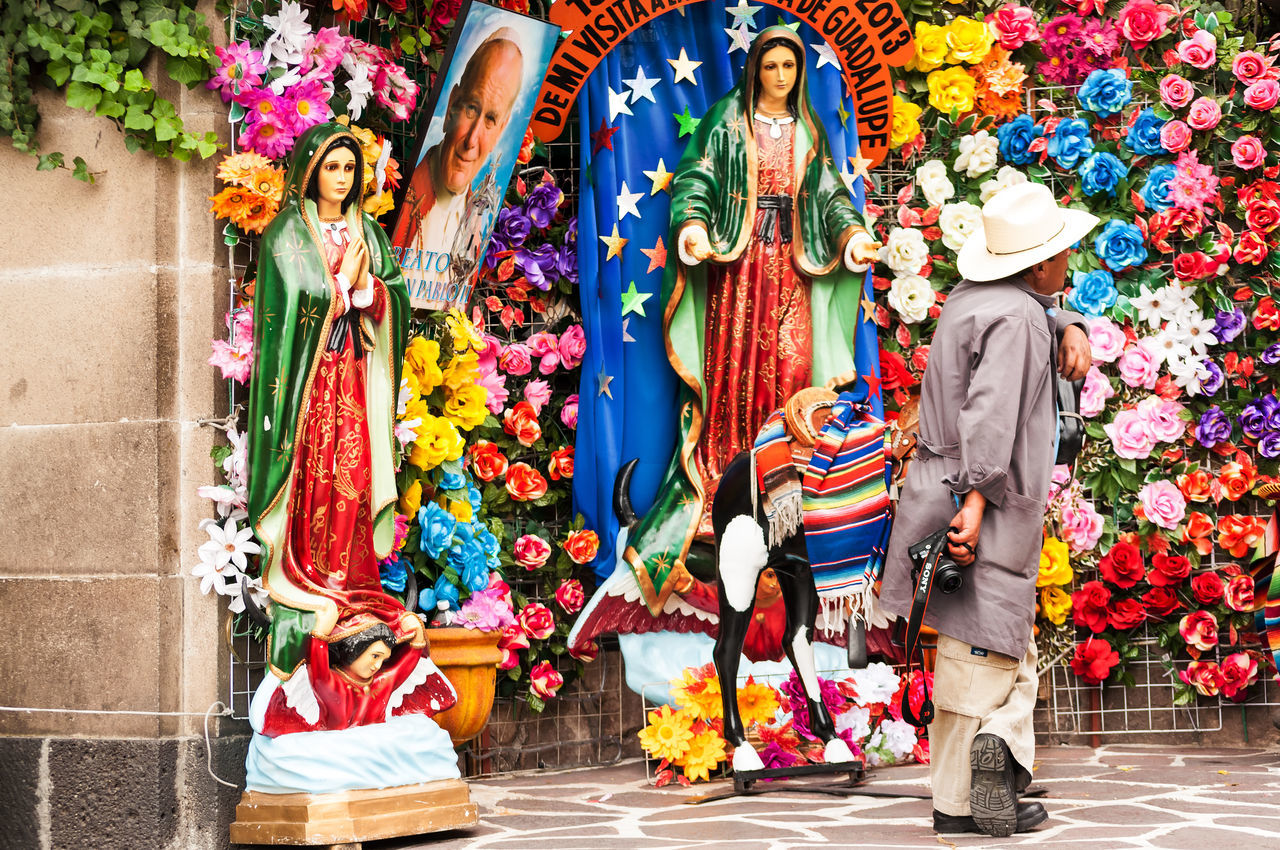MEXICO CITY - MARCH 30: Man with a camera at the Basilica of Our Lady of Guadalupe in Mexico City on March 30, 2013 Catholic Catholicism City Cross Df Faith Flower Guadalupe Hat Historic Holy Man Mary Mexican Mexico Mexicocity  Outdoors Religion Religious  Sacred Spirituality Statue Symbol Urban Virgin