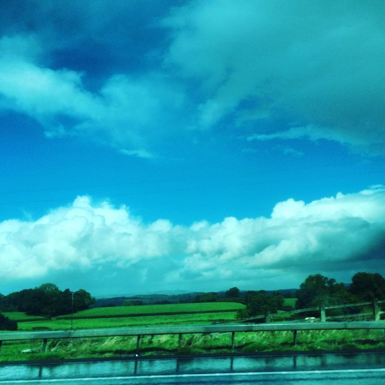 UK Weather 25th September 2016: Frontal rainfall falling over the M5 in Devon, England. Travelling conditions remain challenging as wet weather affects the UK. Tranquil Scene Tranquility Water Tree Scenics Landscape Sky Blue Lake Beauty In Nature Plant Non-urban Scene Travel Destinations Field Day Nature Tourism Rural Scene Waterfront Cloud - Sky