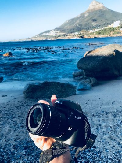Camera - Photographic Equipment Photography Themes Sea Digital Camera Beach Photographing Day Outdoors Technology Nature Sky Camera Water Beauty In Nature Digital Single-lens Reflex Camera One Person Human Hand Close-up People Nikonphotography Nikon