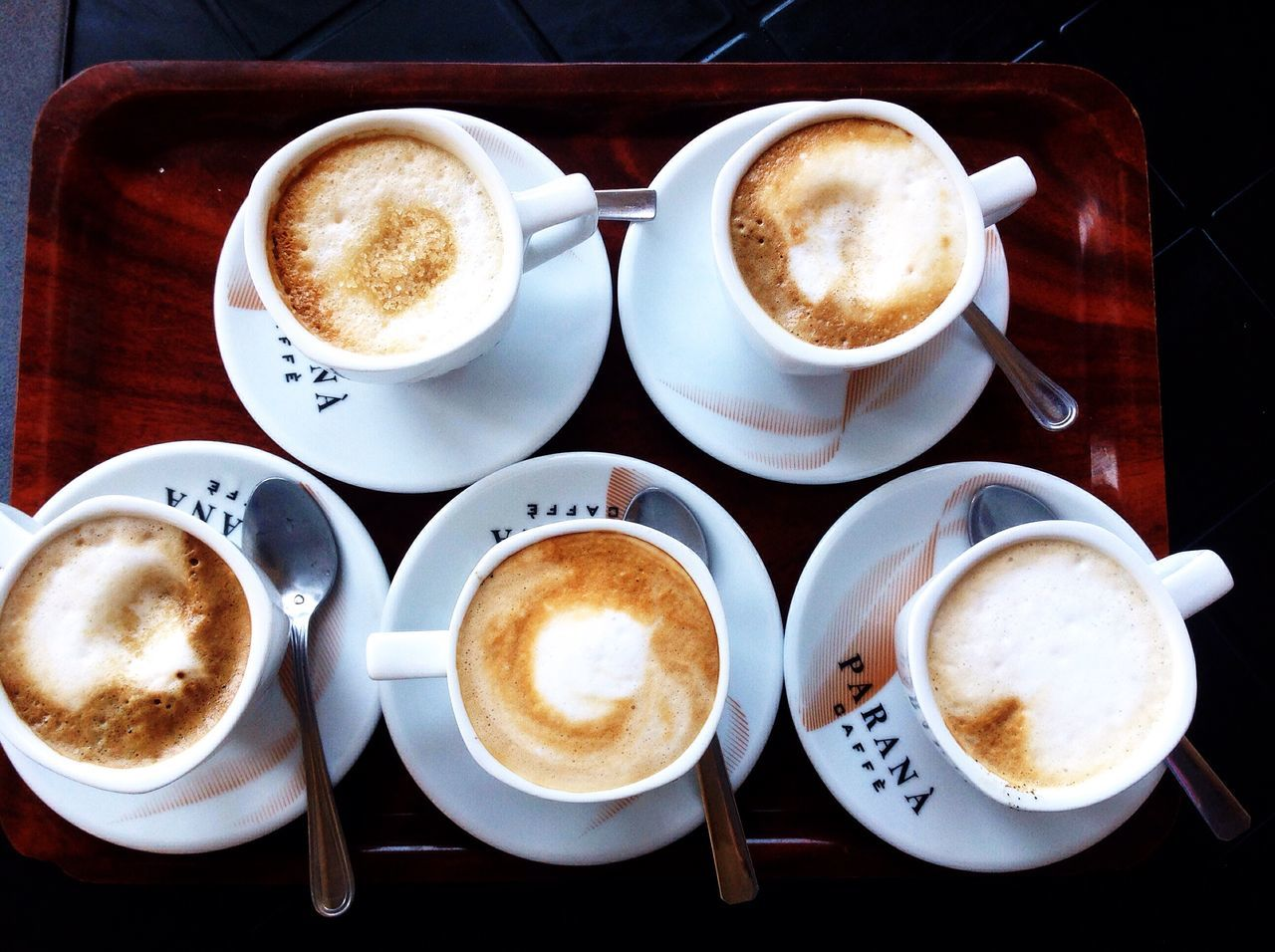 coffee - drink, coffee cup, drink, frothy drink, refreshment, cappuccino, table, food and drink, froth art, cup, saucer, latte, froth, high angle view, freshness, no people, directly above, indoors, close-up, breakfast, day