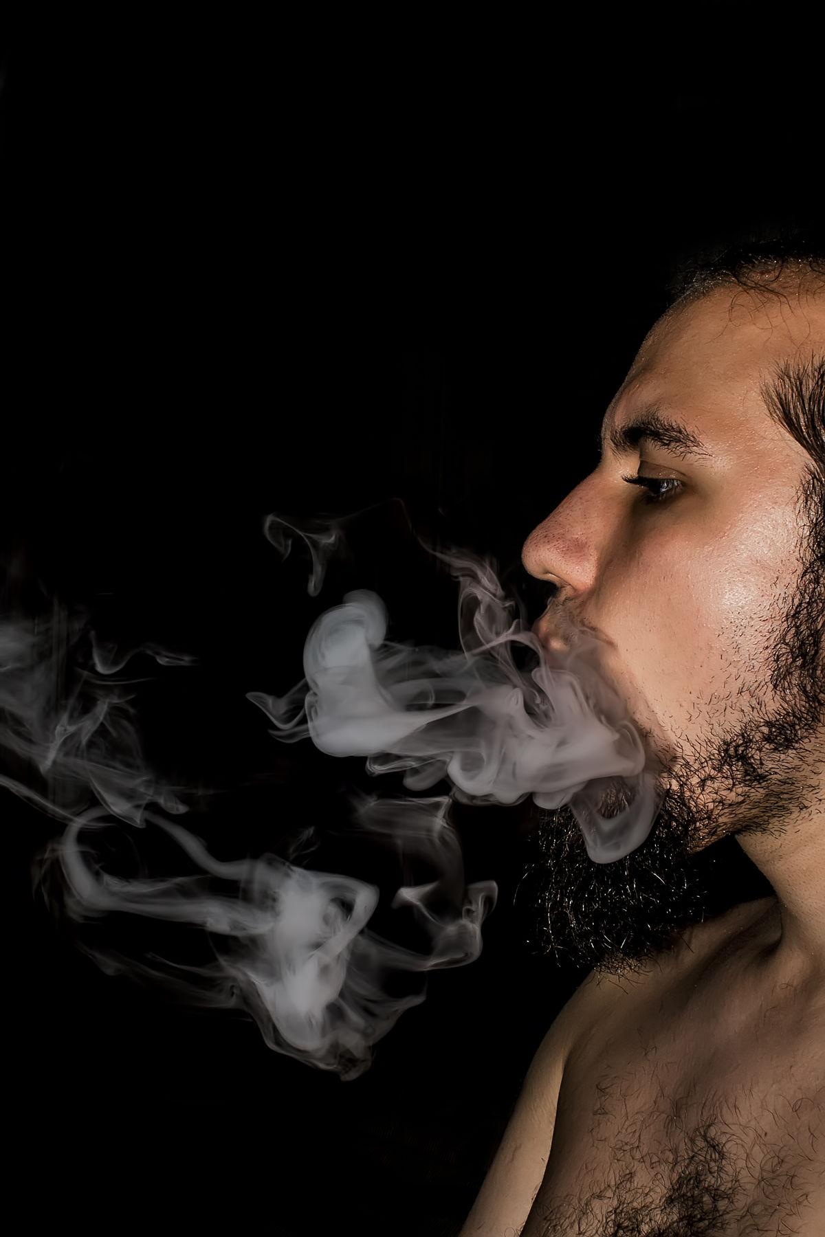 Smoke Black Background Lifestyles One Person Portrait Smoke Spontenous Studio Shot Young Adult