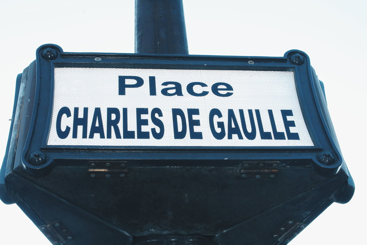Charles De Gaulle Places De Charles De Gaulle Communication No People Close-up Outdoors Road Sign Day Sky Paris France Vacations Tourism Travel City Travel Destinations Tourist Attraction  Tourist Destination Metro Metro Station Station Places Charles De Gaulle Etoile Sign Signboard