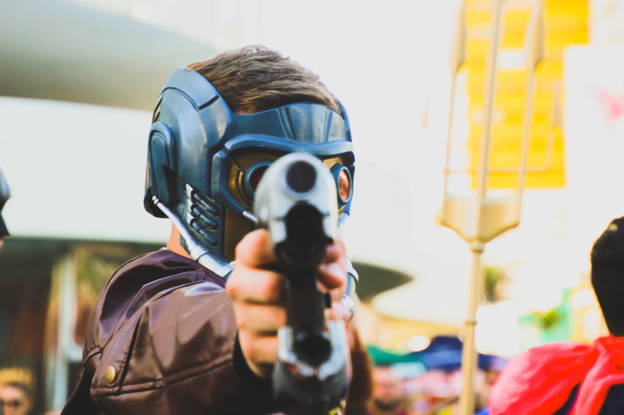 Aiming Arts Culture And Entertainment Costume Day Disguise Fancy Dress Focus On Foreground Gun Halloween Headshot Headwear Helmet Leisure Activity Lifestyles Men Outdoors People Real People Standing Street Street Parade Street Photography Supanova Superhero Superheroes