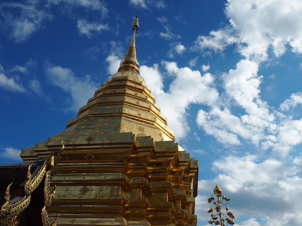 religion, spirituality, place of worship, sky, pagoda, architecture, cloud - sky, built structure, low angle view, building exterior, gold colored, day, no people, gold, outdoors, ancient, travel destinations