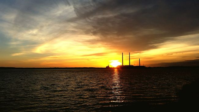 Sunset Fuel And Power Generation Reflection Water Electricity  Business Finance And Industry Nature Sea Environment Horizontal Alternative Energy Tranquility Technology Horizon Over Water Wind Turbine No People Outdoors Industry Refraction Sky